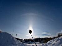 Peculiar 23° plate arc with an elliptical halo