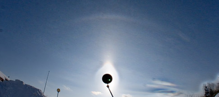 Peculiar 23° plate arc with an elliptical halo