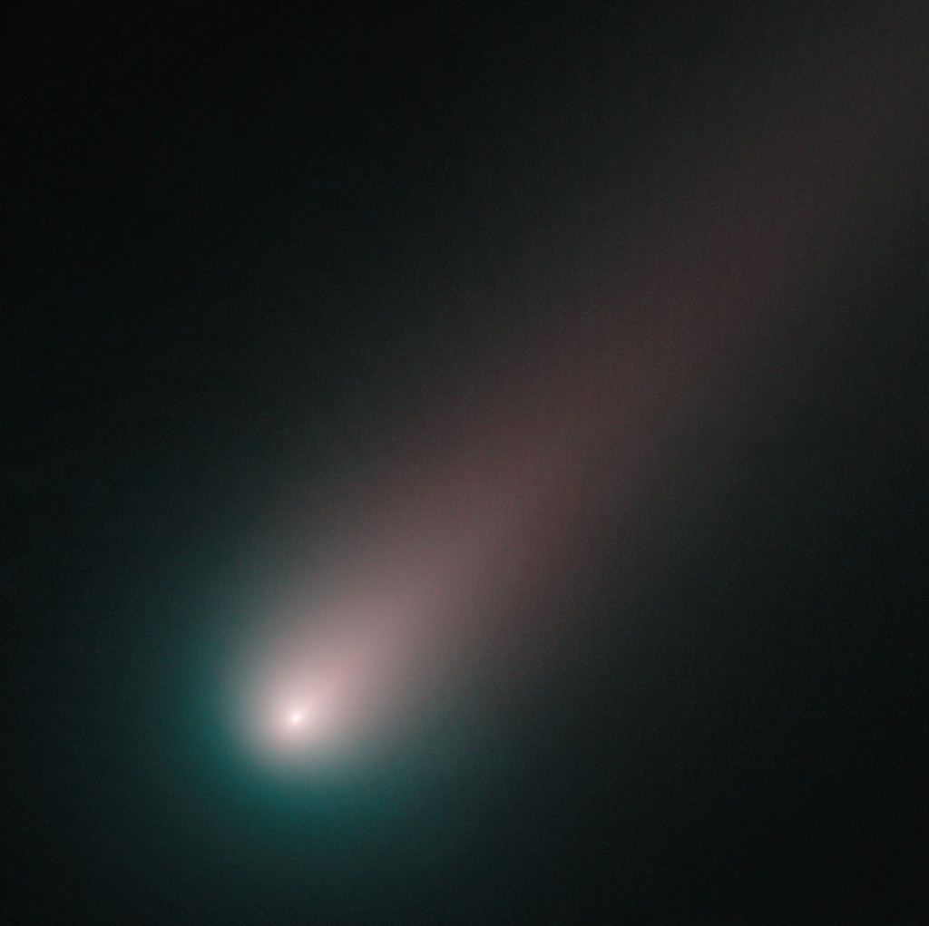 As of mid-November, ISON is officially upon us. Hubble has taken its closest look yet at the innermost region of the comet, where geysers of sublimating ice are fueling a spectacular tail. Made from observations on 2 November 2013, the image combines pictures of ISON taken through blue and red filters. The round coma around ISON's nucleus is blue and the tail has a redder hue. Ice and gas in the coma reflect blue light from the Sun, while dust grains in the tail reflect more red light than blue light. This is the most colour separation seen so far in ISON and the comet, nearer than ever to the Sun, is brighter and more structured than ever before. Comet ISON will come closest to the Sun on November 28, a point in its orbit known as perihelion. Comet ISON was fairly quiet until 1 November 2013, when it experienced an outburst that doubled the amount of gas the comet emitted. After this image was taken, a second outburst shook the comet, increasing its activity by a factor of ten. Over the past couple of nights, the comet has stabilised at its new level of activity. It is now bright enough to be seen with a good pair of binoculars from a dark site, in the morning skies towards the East. Hubble Heritage release ISONblog, an online source offering analysis of Comet ISON by Hubble Space Telescope astronomers and staff at the Space Telescope Science Institute in Baltimore, USA.